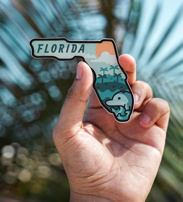 hand holding magnet shaped like florida